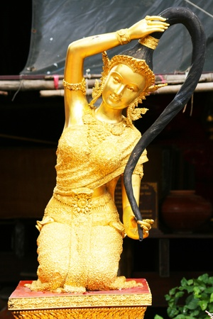 Gold angel statue, Thailand  photo
