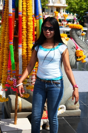 Filipino girl at a shrine in Bangkok, Thailand  Stock Photo - 13852151