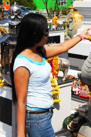 Filipino girl at a shrine in Bangkok, Thailand  photo