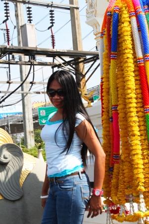 Filipino girl at a shrine in Bangkok, Thailand  photo