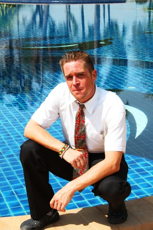 Man outside a swimming pool in Thailand  Stock Photo - 13876798