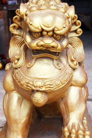 lion figurines: Gold lion statue in Thailand
