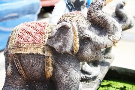 Stone elephant sculpture in a garden in Thailand Stock Photo - 14196633