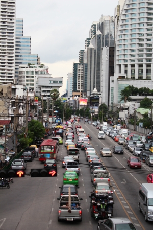 BANGKOK - JUNE 27  Busy mid day traffic traveling under Asok skytrain station in Sukumvit on June 27, 2012 in Bangkok, Thailand