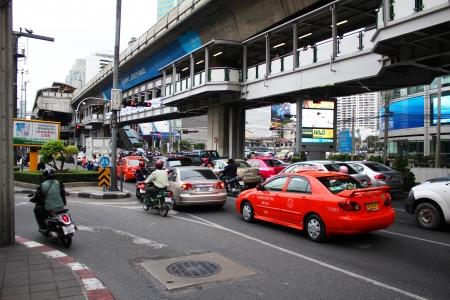 BANGKOK - JUNE 27  Busy mid day traffic traveling under Asok skytrain station in Sukumvit on June 27, 2012 in Bangkok, Thailand