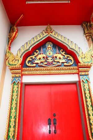 Red door to a temple in Thailand  photo