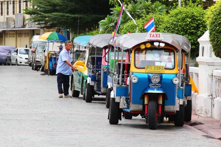 BANGKOK - AUGUST 19  Thai Tuk Tuk taxis on Khaosarn road on August 19, 2012 in Bangkok, Thailand