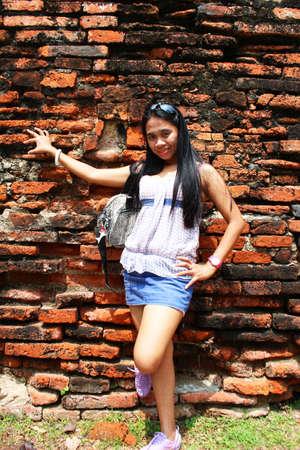 Asian woman at a temple ruins in Ayutthaya, Thailand  photo