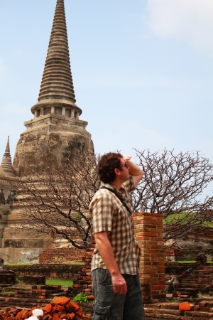 Traveler at a ruined temple in Ayutthaya, Thailand   photo