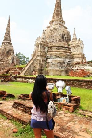 Woman taking photos at Wat Phra Si Sanphet, Ayutthaya, Thailand photo