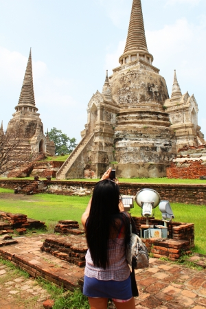 Woman taking photos at Wat Phra Si Sanphet, Ayutthaya, Thailand photo