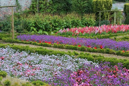 path cottage garden: Walled Flower Garden With Box Hedges, Summer, England Stock Photo