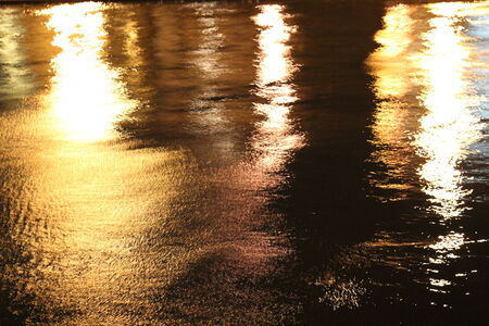 Golden Reflections on River at Night, England  photo