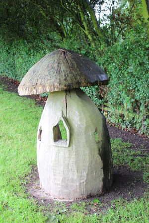 Wooden Toadstool Playhouse, England  Stock Photo
