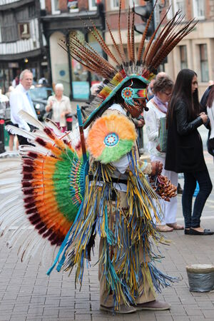 busker: Aztec Maya Busker in Traditional Dress, England.