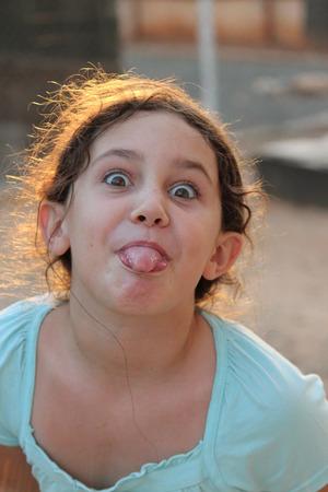 anglo saxon: Girl Pulling Faces at Camera, England.