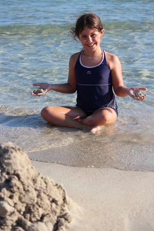 anglo saxon: Girl Playing On Beach With Sea, Cyprus.