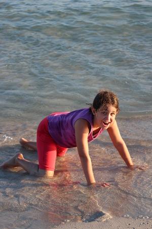 frizz: Girl Kneeling in the Sea, Cyprus.