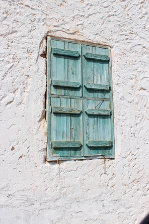 louvered: Old Green Shutters,  Famagusta, Cyprus.
