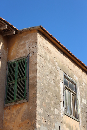 louvered: Old Shutter on Mediterranean Property, Cyprus.