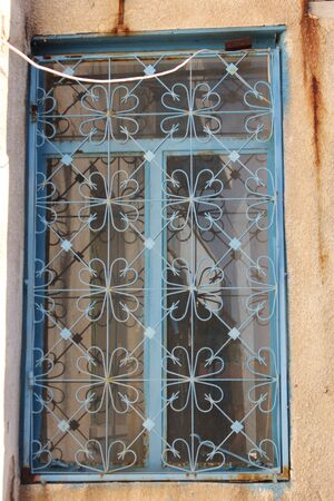 louvered: Wrought Iron Pattern on Window, Cyprus.