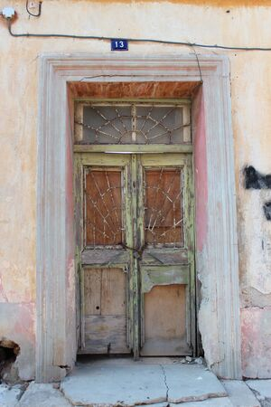 louvered: Old Door on Derelict Building, Cyprus.