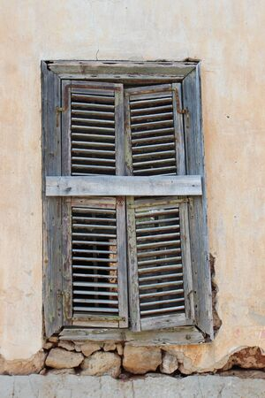 louvered: Old Shutter on Derelict Building, Cyprus.