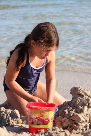 anglo saxon: Girl Building Sandcastles on Beach, Cyprus.