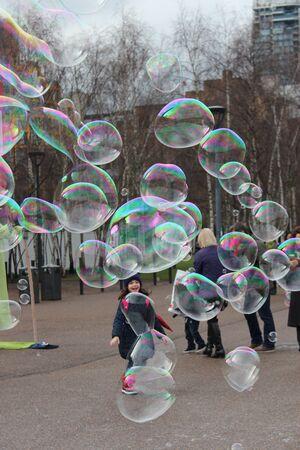 entertain: Giant Rainbow Bubbles Entertain Crowd, London, England.