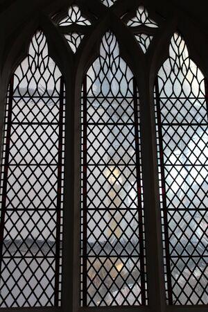 Diamond Panes of Glass in Church Window, England.
