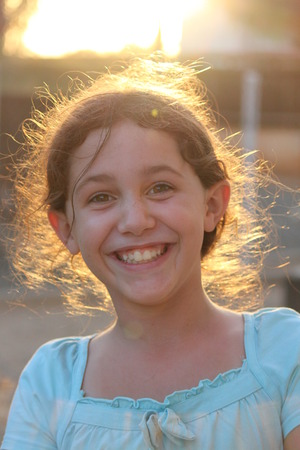 wisps: Animated Girl Laughing at Camera in Sunset, Cyprus.