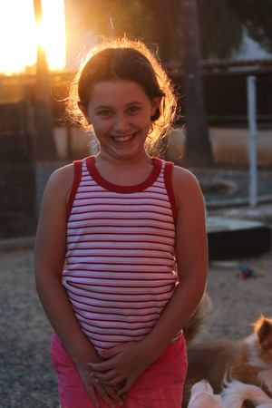 wisps: Animated Girl Pulling Faces at Camera in Sunset, Cyprus.