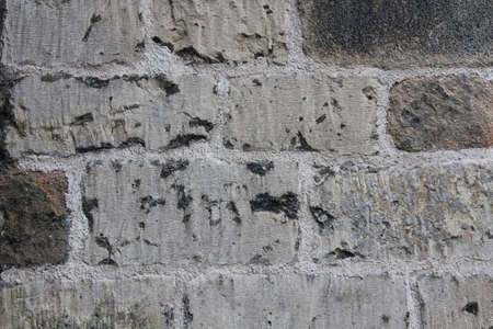 subdued: Medieval Stone Church Wall, Yorkshire, England.