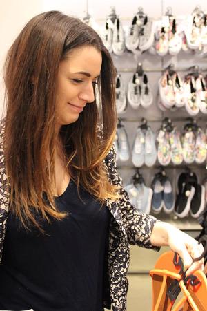 rummage: Young Woman Shopping in London England Stock Photo
