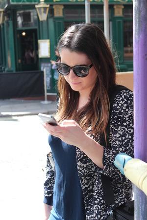 ennui: Young Woman Tourist In Sunshine London England.