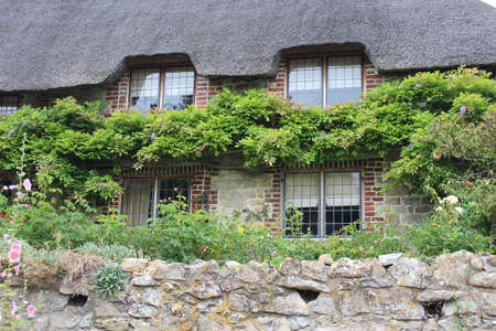 thatched cottage: Thatched Cottage in Rural England.
