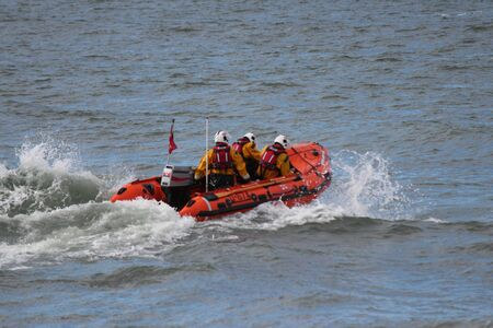 north yorkshire: Dinghy Racing Against Waves At Whitby, Yorkshire.