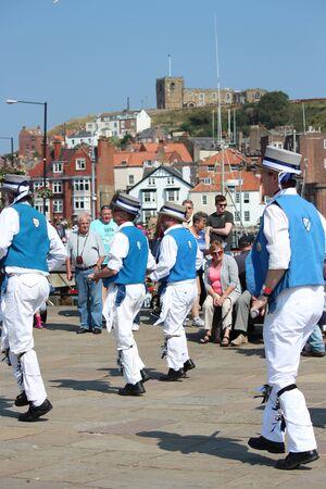 morris: Morris Men Dancing at Whitby Folk Festival, August 2015. Editorial