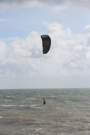 silver surfer: Man In Wetsuit Paragliding, England, September 2015.