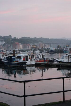 pink sunset: Whitby Harbour in Pink Sunset, Yorkshire, England.