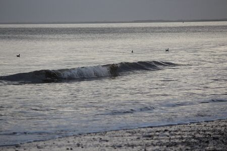 irridescent: Bridlington Beach At Sunset, Yorkshire. Stock Photo
