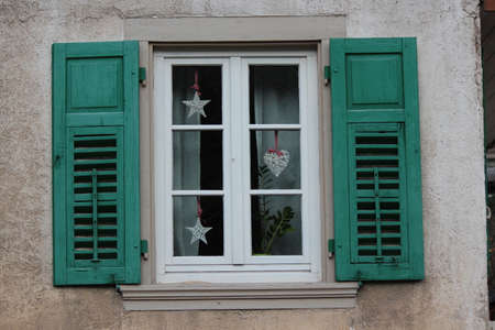 louvered: Green Shuttered Window, Germany. Stock Photo