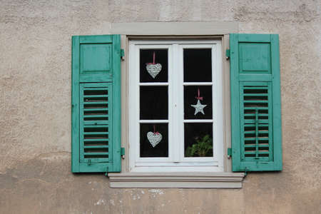 louvered: Green Shuttered Window On German House.