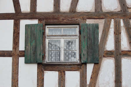 louvered: Dull Green Shuttered Window On Traditional House, Germany.
