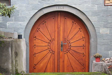 outbuilding: Arched Doorway in Grey Stone Wall, Germany.