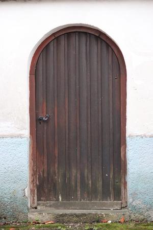 mahogany: Arched Mahogany Brown Wooden Door, Germany.