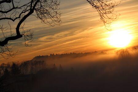 irridescent: Blazing Orange Sunset Over Layer of Mist, Schwarzwald.