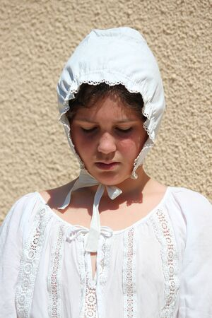 Young Girl Wearing Victorian Cotton Bonnet. Stock Photo