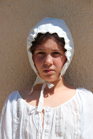 bonnet: Young Girl Wearing Victorian Cotton Bonnet. Stock Photo