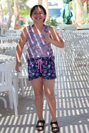wisps: Young Girl Dancing in Shaded Beach Bar